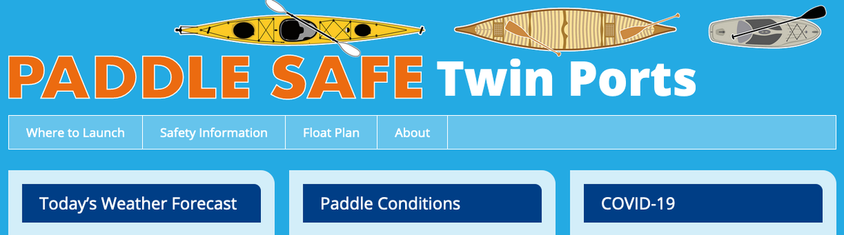 Paddle Safe Twin Ports text and cartoon kayak, canoe, paddle board